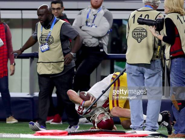 Sam Darnold of the USC Trojans is shoved out of bounds on a late hit by the Ohio State Buckeyes in the fourth quarter during the Goodyear Cotton Bowl...