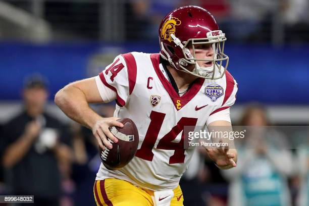 Sam Darnold of the USC Trojans looks for an open receiver against the Ohio State Buckeyes during the Goodyear Cotton Bowl Classic at ATT Stadium on...