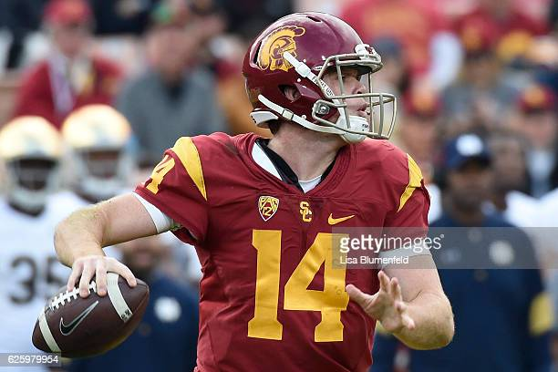 Sam Darnold of the USC Trojans looks to pass the ball in the first quarter against the Notre Dame Fighting Irish at Los Angeles Memorial Coliseum on...