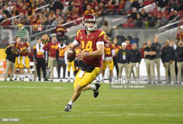 Sam Darnold of the USC Trojans looks to throw a pass against the Stanford Cardinal during the Pac12 Football Championship Game at Levi's Stadium on...