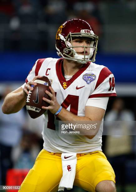 Sam Darnold of the USC Trojans looks to throw against the Ohio State Buckeyes in the first half of the 82nd Goodyear Cotton Bowl Classic between USC...