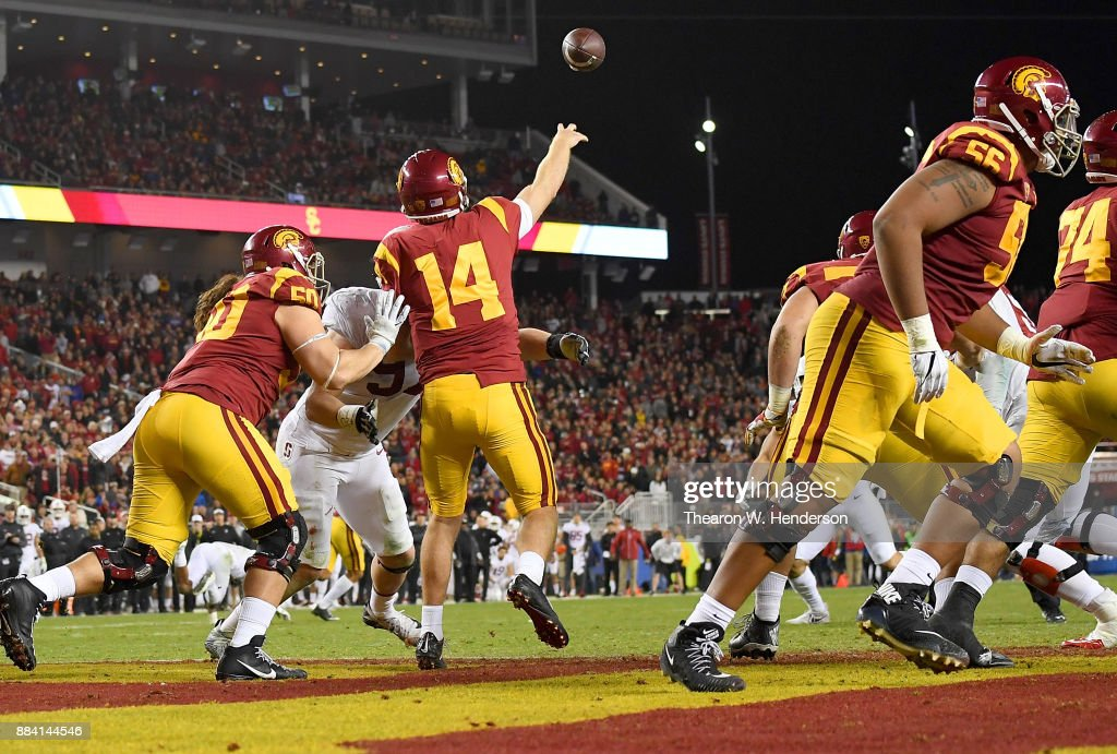 Sam Darnold #14 of the USC Trojans looks to throws and completes a deep pass from his own endzone against the Stanford Cardinal during the Pac-12 Football Championship Game at Levi's Stadium on December 1, 2017 in Santa Clara, California. The Trojans won the game 31-28.