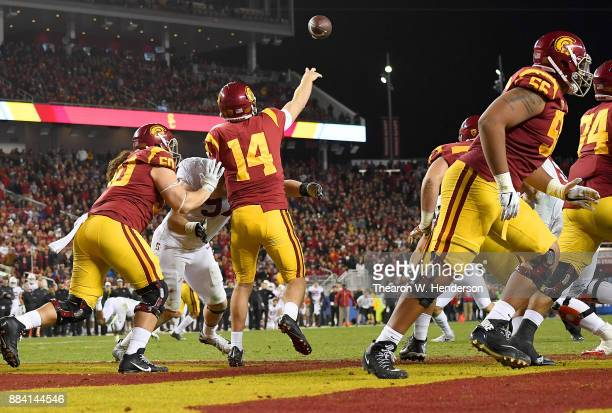 Sam Darnold of the USC Trojans looks to throws and completes a deep pass from his own endzone against the Stanford Cardinal during the Pac12 Football...