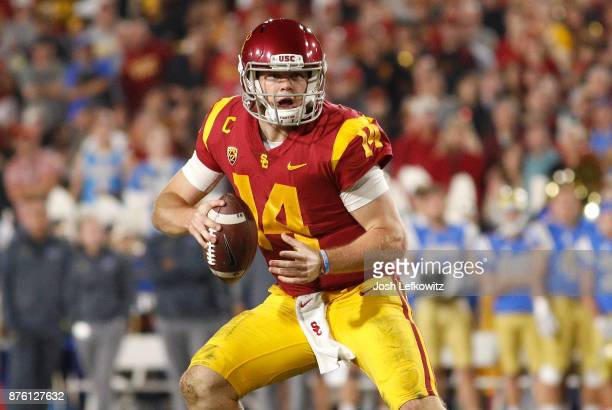 Sam Darnold of the USC Trojans prepares to pass the ball during the NCAA college football game against the UCLA Bruins at the Los Angeles Memorial...