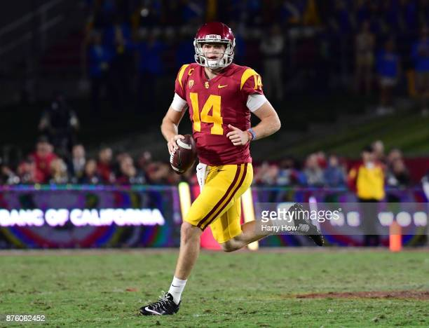 Sam Darnold of the USC Trojans scrambles out of the pocket during the second quarter against the UCLA Bruins at Los Angeles Memorial Coliseum on...