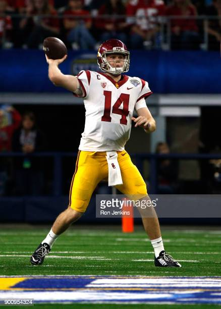 Sam Darnold of the USC Trojans throws against the Ohio State Buckeyes in the first half of the 82nd Goodyear Cotton Bowl Classic between USC and Ohio...