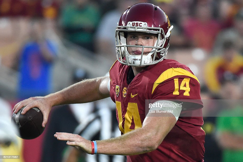 Sam Darnold #14 of the USC Trojans throws the ball to score a touchdown in the second quarter against the Oregon Ducks at Los Angeles Memorial Coliseum on November 5, 2016 in Los Angeles, California.