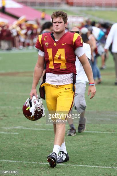Sam Darnold of the USC Trojans walks off the field after a comeback win 4931 against the Western Michigan Broncos at Los Angeles Memorial Coliseum on...