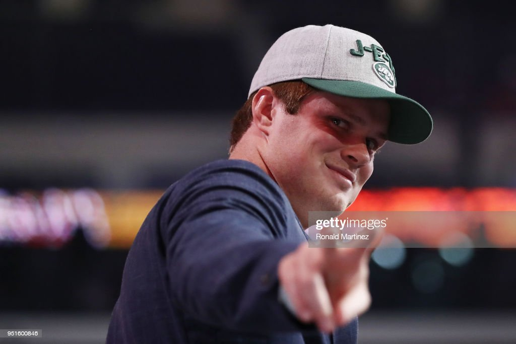 Sam Darnold of USC gestures after being picked #3 overall by the New York Jets during the first round of the 2018 NFL Draft at AT&T Stadium on April 26, 2018 in Arlington, Texas.