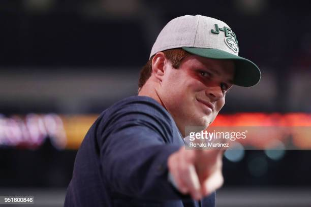 Sam Darnold of USC gestures after being picked overall by the New York Jets during the first round of the 2018 NFL Draft at ATT Stadium on April 26...