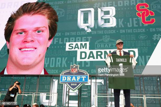 Sam Darnold of USC poses after being picked overall by the New York Jets during the first round of the 2018 NFL Draft at AT&T Stadium on April 26,...