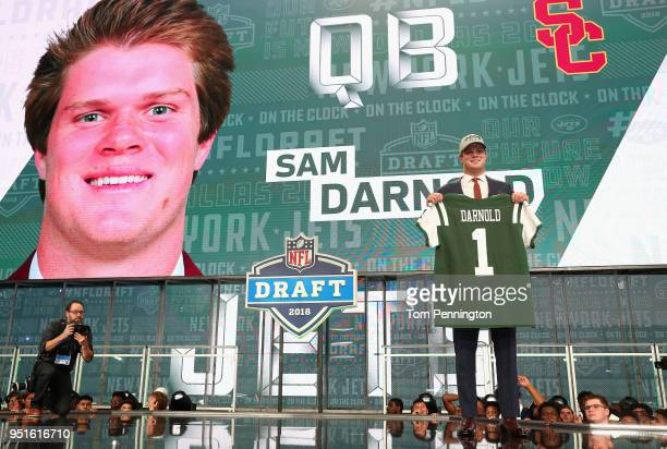 Sam Darnold of USC poses after being picked overall by the New York Jets during the first round of the 2018 NFL Draft at ATT Stadium on April 26 2018...