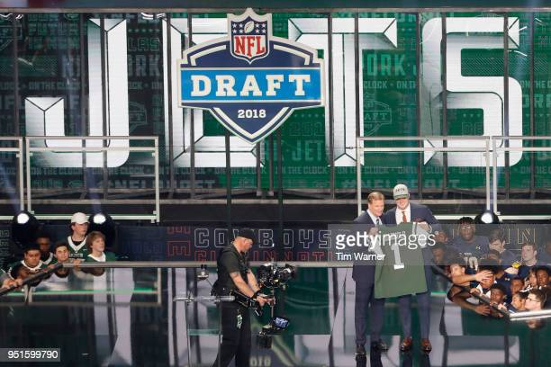 Sam Darnold of USC poses with NFL Commissioner Roger Goodell after being picked overall by the New York Jets during the first round of the 2018 NFL...