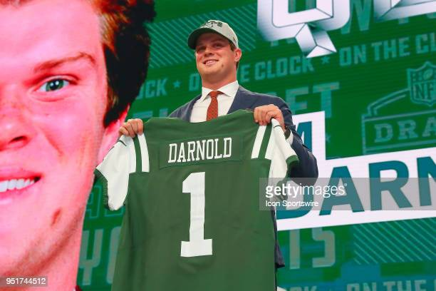 Sam Darnold poses for photos with a jersey as the third overall pick by the New York Jets during the first round at the 2018 NFL Draft at ATT Statium...