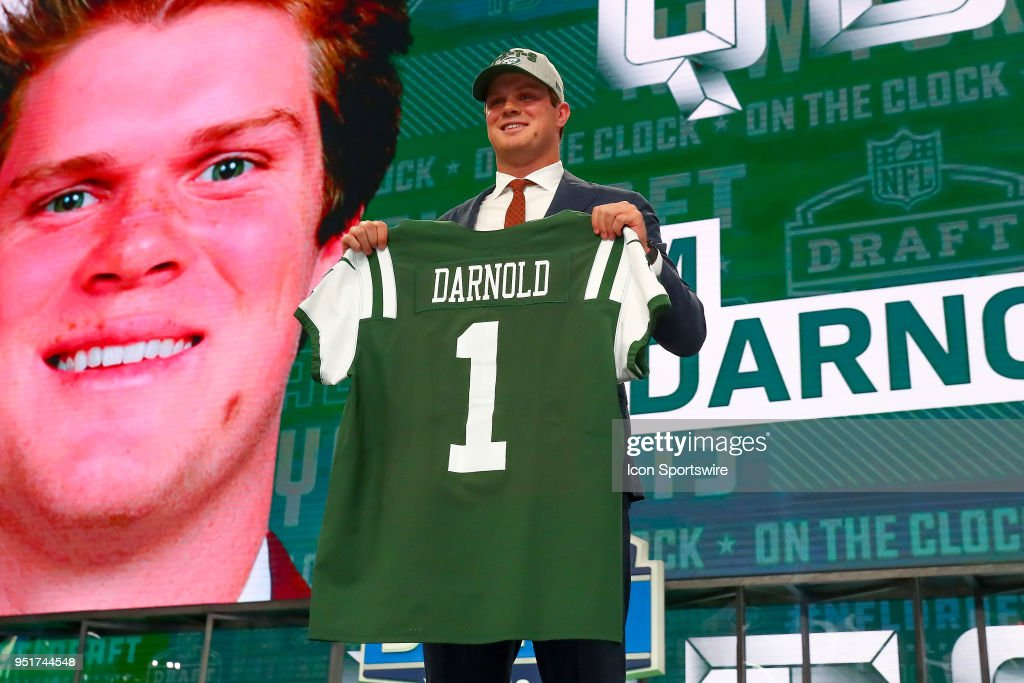 Sam Darnold poses for photos with a jersey as the third overall pick by the New York Jets during the first round at the 2018 NFL Draft at AT&T Statium on April 26, 2018 at AT&T Stadium in Arlington Texas.