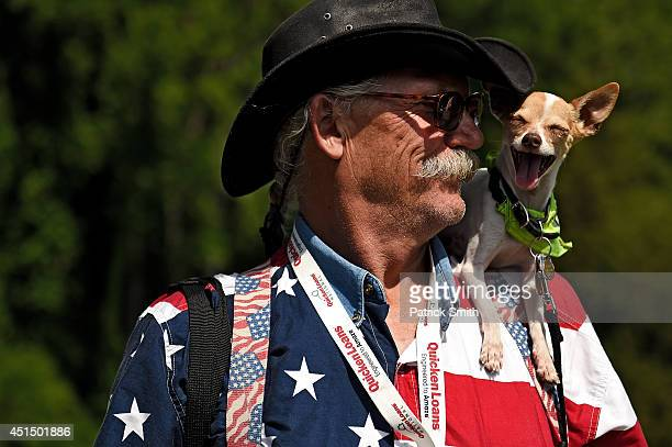 Sam Daugherty and his dog Rocket J Squirrel pose for a portrait during the third round of the Quicken Loans National at Congressional Country Club on...