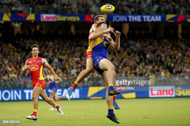 Sam Day of the Suns clashes with Jeremy McGovern of the Eagles during the round four AFL match between the West Coast Eagles and the Gold Coast Suns...