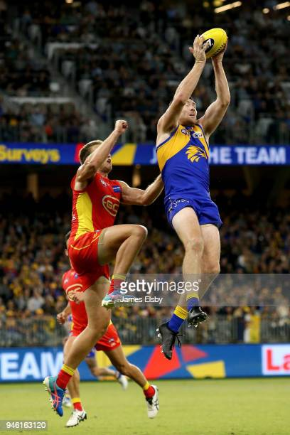 Sam Day of the Suns flies with Jeremy McGovern of the Eagles during the round four AFL match between the West Coast Eagles and the Gold Coast Suns at...