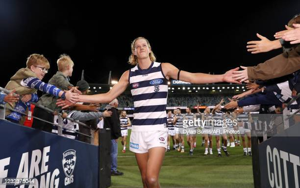 Sam De Koning of the Cats celebrates a win with fans on debut during the 2021 AFL Round 05 match between the Geelong Cats and the North Melbourne...