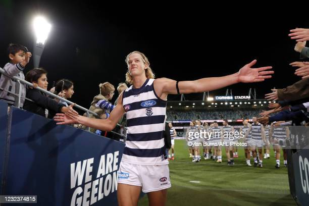 Sam De Koning of the Cats celebrates a win with fans on his debut during the 2021 AFL Round 05 match between the Geelong Cats and the North Melbourne...