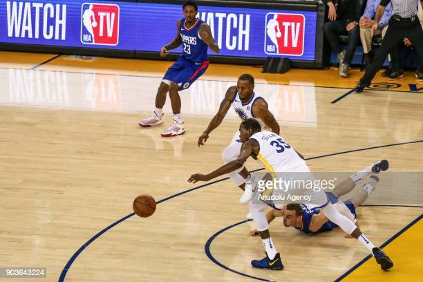 Sam Dekker of LA Clippers in action against Andre Iguodala and Kevin Durant of Golden State Warriors during the NBA basketball game between LA...