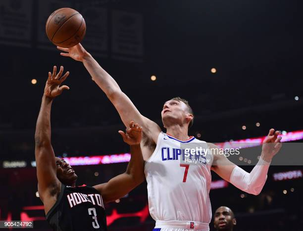 Sam Dekker of the LA Clippers blocks the shot of Chris Paul of the Houston Rockets during the first half at Staples Center on January 15 2018 in Los...