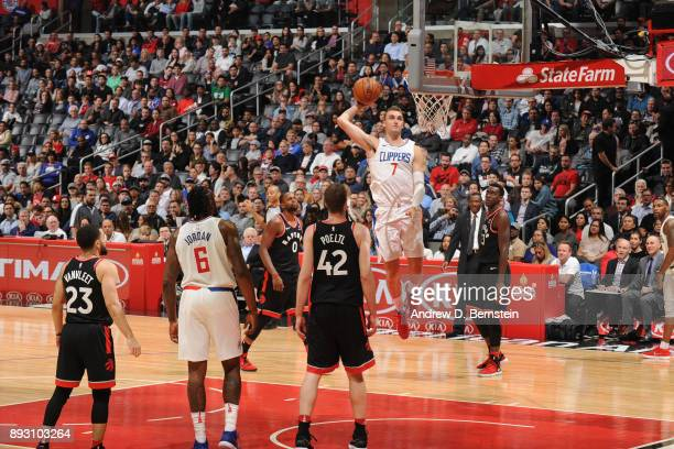 Sam Dekker of the LA Clippers dunks the ball against the Toronto Raptors on December 11 2017 at STAPLES Center in Los Angeles California NOTE TO USER...