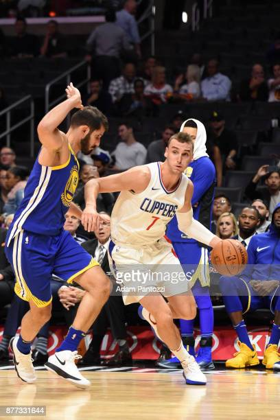 Sam Dekker of the LA Clippers handles the ball against the Golden State Warriors on October 30 2017 at STAPLES Center in Los Angeles California NOTE...