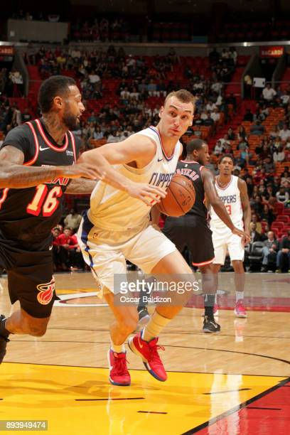 Sam Dekker of the LA Clippers handles the ball against the Miami Heat on December 16 2017 at American Airlines Arena in Miami Florida NOTE TO USER...