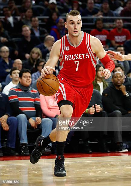 Sam Dekker of the Houston Rockets drives against the Detroit Pistons at the Palace of Auburn Hills on November 21 2016 in Auburn Hills Michigan NOTE...