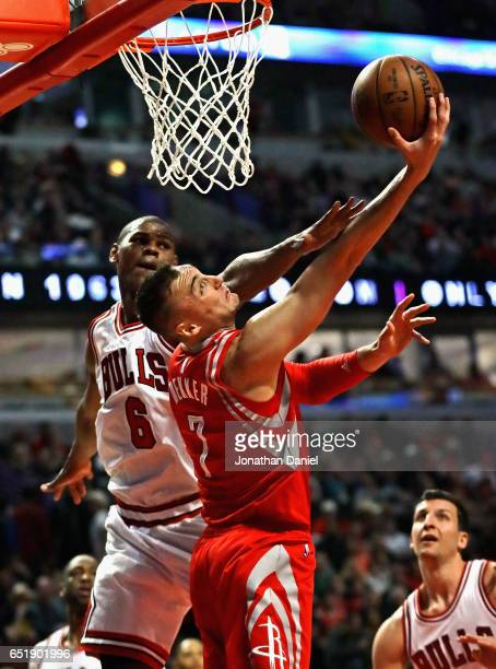 Sam Dekker of the Houston Rockets is fouled by Cristiano Felicio of the Chicago Bulls at the United Center on March 10 2017 in Chicago Illinois NOTE...