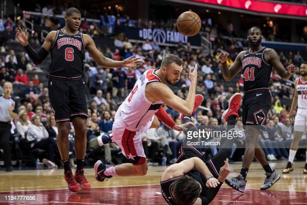 Sam Dekker of the Washington Wizards collides with Ryan Arcidiacono of the Chicago Bulls during the first half at Capital One Arena on April 3 2019...