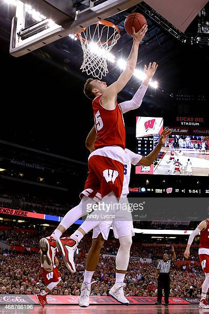 Sam Dekker of the Wisconsin Badgers drives to the basket against Jahlil Okafor of the Duke Blue Devils in the first half during the NCAA Men's Final...