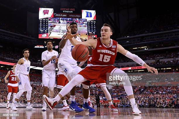 Sam Dekker of the Wisconsin Badgers goes for a loose ball against Amile Jefferson of the Duke Blue Devils in the first half during the NCAA Men's...