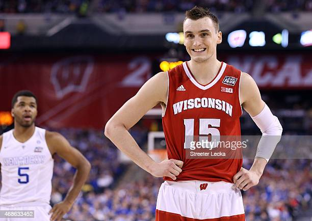 Sam Dekker of the Wisconsin Badgers reacts after a play in the first half as Andrew Harrison of the Kentucky Wildcats looks on during the NCAA Men's...