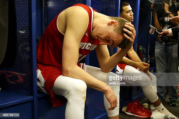 Sam Dekker of the Wisconsin Badgers reacts in the locker room after being defeated by the Duke Blue Devils during the NCAA Men's Final Four National...
