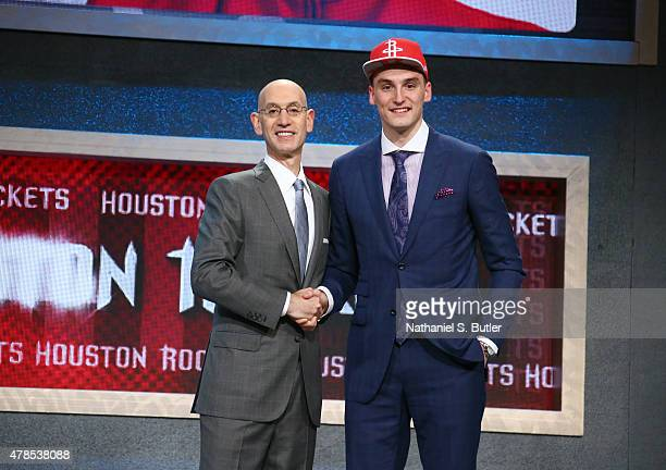 Sam Dekker shakes hands with NBA Commissioner Adam Silver after being selected number eighteen overall by the Houston Rockets during the 2015 NBA...