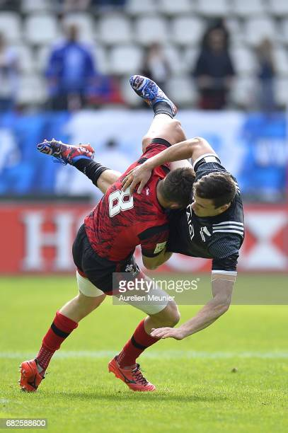 Sam Dickson of New Zealand is tackled by Lloyd Evans of Wales during the HSBC rugby sevens match between New Zealand and Wales on May 13 2017 in...