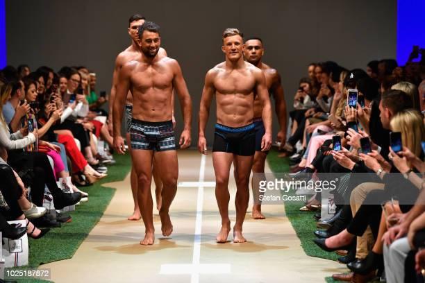 Sam Dickson of the New Zealand rugby sevens team Kurt Baker Damian McKenzie and Ngani Laumape of the New Zealand All Blacks walk the runway during...