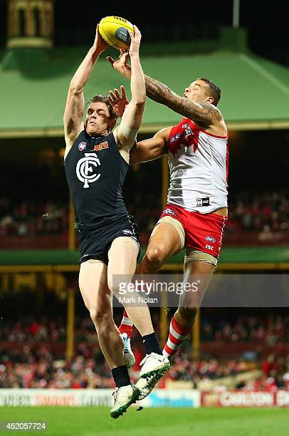 Sam Docherty of the Blues and Lance Franklin of the Swans contest a mark during the round 17 AFL match between the Sydney Swans and the Carlton Blues...