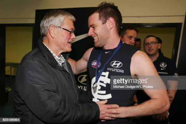 Sam Docherty of the Blues celebrates the win with Blues coaching legend David Parkin during the round 22 AFL match between the Carlton Blues and the...
