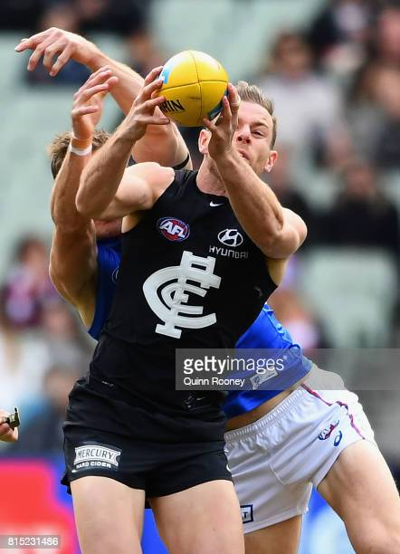 Sam Docherty of the Blues marks infront of Dale Morris of the Bulldogs during the round 17 AFL match between the Carlton Blues and the Western...