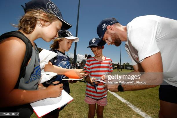 Sam Docherty of the Blues signs autographs during the Carlton Blues AFL preseason training session at Maroochydore Multisport Complex on December 17...