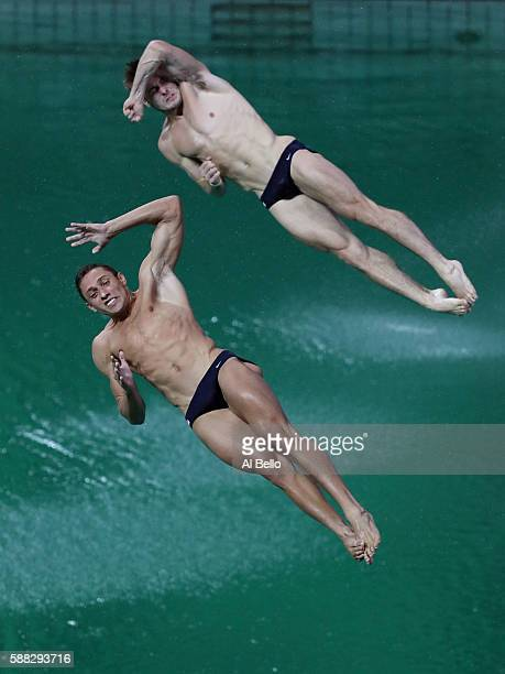 Sam Dorman and Mike Hixon of the United States compete in the Men's Diving Synchronised 3m Springboard Final on Day 5 of the Rio 2016 Olympic Games...
