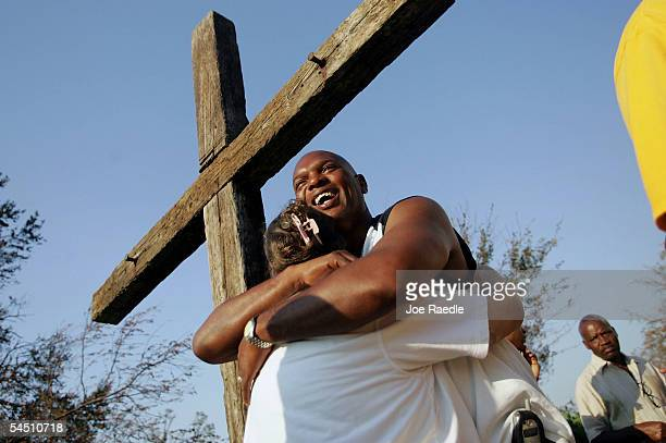 Sam Dorsey gives Holly Hayden a hug as they leave the St Rose De Lima mass September 4 2005 in Bay St Louis Mississippi Dorsey and Hayden both lost...