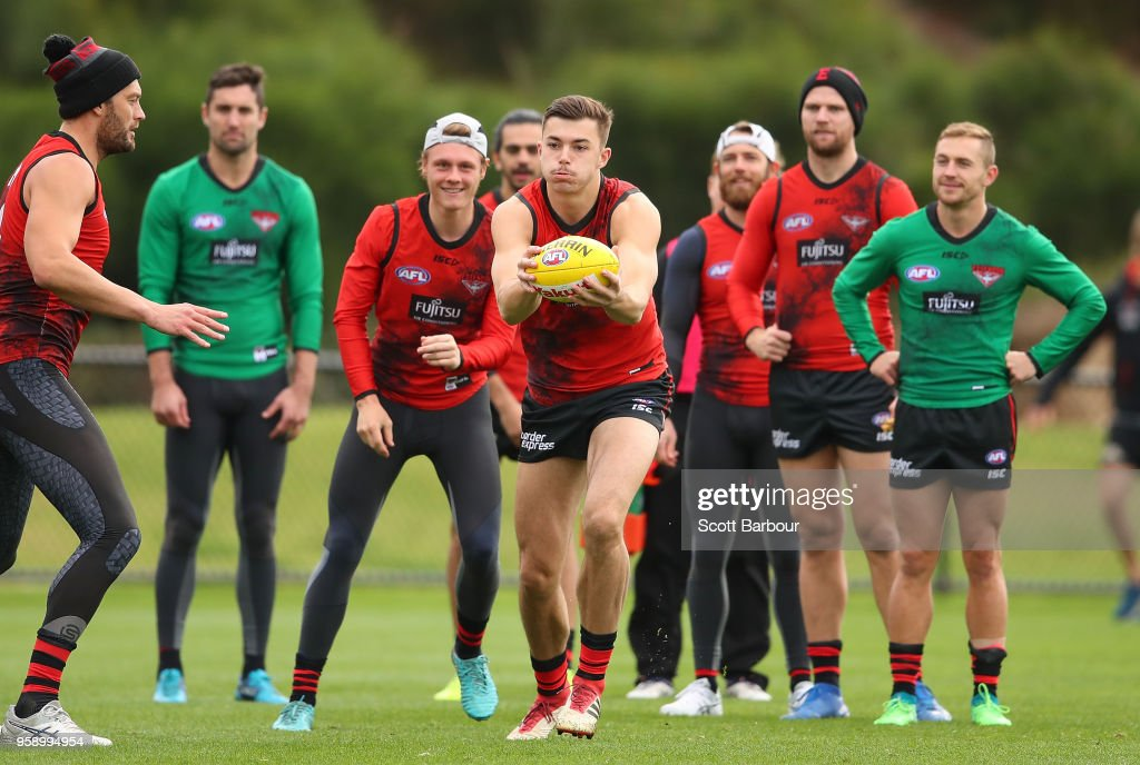 Sam Draper of the Bombers runs with the ball during an Essendon Bombers AFL training session at The Hangar on May 16, 2018 in Melbourne, Australia.