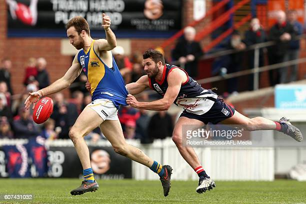 Sam Dunell of Williamstown is tackled during the VFL Preliminary Final match between the Casey Scorpions and Williamstown at North Port Oval on...