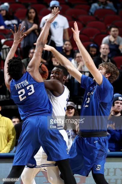 Sam Dunkum of the Creighton Bluejays is surrounded by Justin Patton and Toby Hegner of the Creighton Bluejays in the firs thalf on February 15 2017...