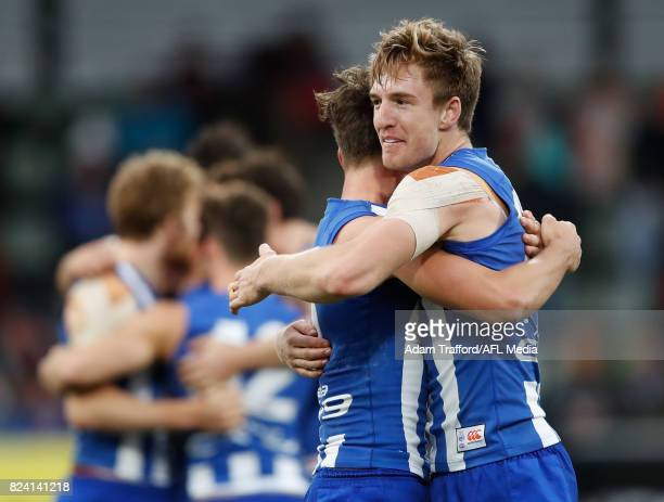 Sam Durdin of the Kangaroos and Ryan Clarke of the Kangaroos celebrate on the final siren during the 2017 AFL round 19 match between the North...