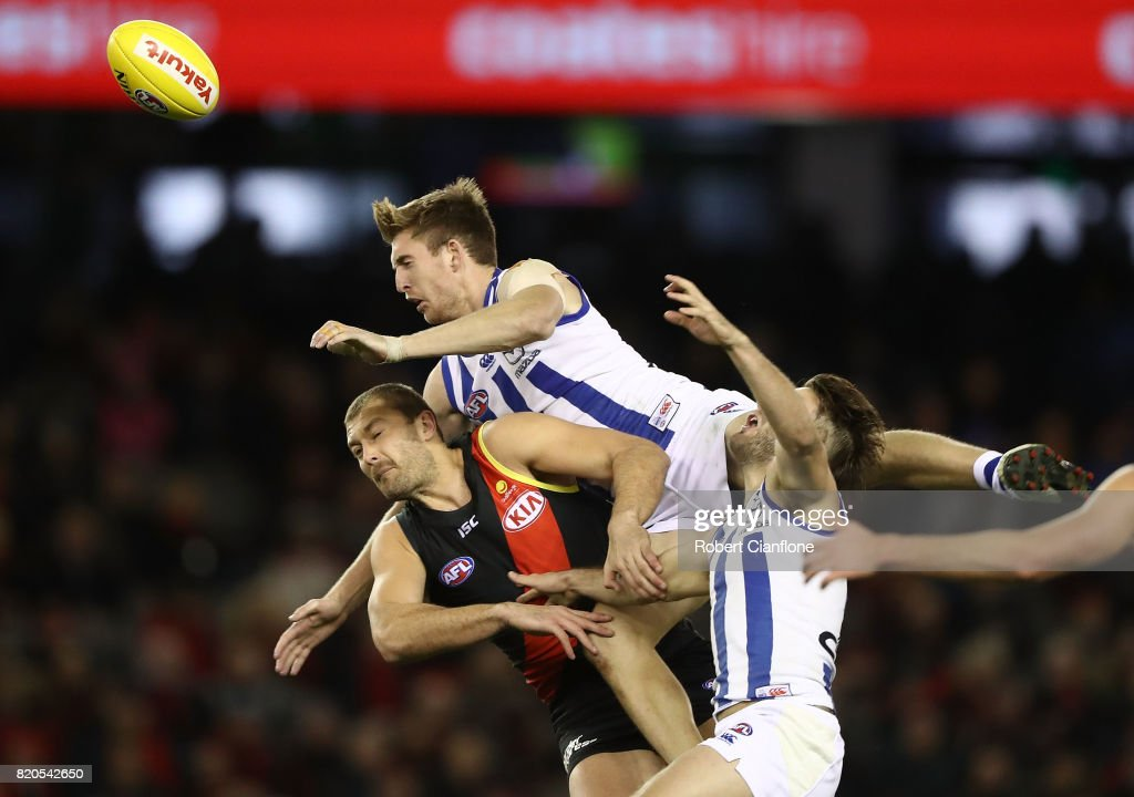 Sam Durdin of the Kangaroos leaps for the ball during the round 18 AFL match between the Essendon Bombers and the North Melbourne Kangaroos at Etihad Stadium on July 22, 2017 in Melbourne, Australia.